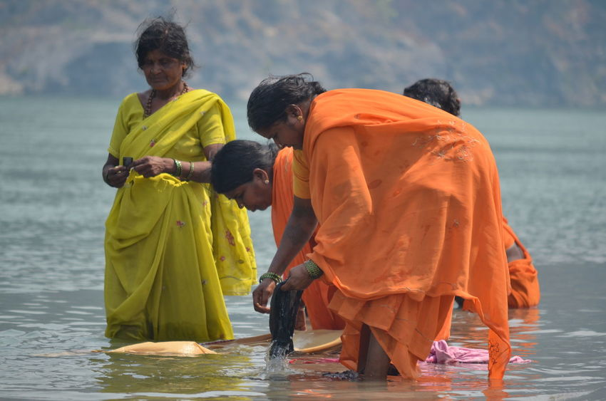 Colors Ganga River Hands India Meditation Orange Purification Red Reflection Rishikesh Ritual Washing River Bank  Sand Spirituality Travel Photography Unity Water Yoga Capital First Eyeem Photo