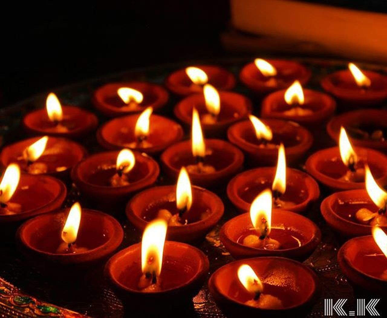 flame, candle, burning, heat - temperature, glowing, indoors, illuminated, no people, religion, large group of objects, close-up, spirituality, place of worship, diya - oil lamp, black background