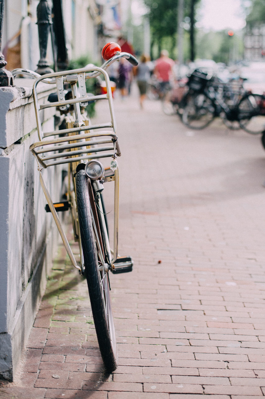 bicycle, land vehicle, mode of transport, transportation, street, day, outdoors, stationary, bicycle rack, no people, city, close-up
