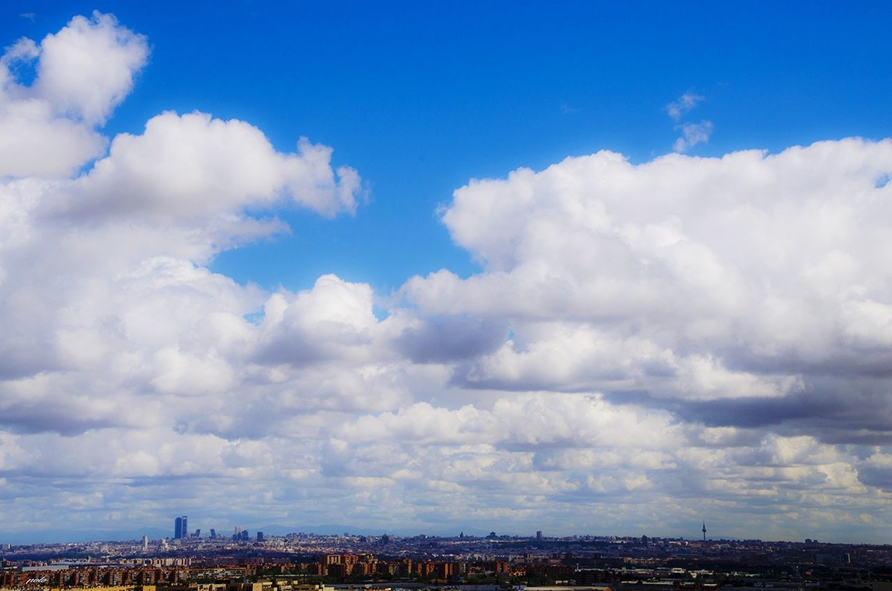 cloud - sky, cityscape, sky, architecture, building exterior, city, built structure, outdoors, day, blue, no people, nature, beauty in nature