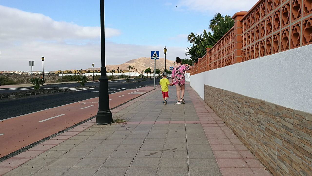 Full Length Day Real People Children Siblings Brother Sister Kids Walking Holiday Vacation Fuerteventura Sunshine SPAIN Road Path Wall Summer Summer Clothing Canary Islands