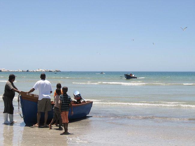 Family of fishermen Seafoods Fresh Sell Selling Boat Fishing Fishermen Fisherman Family Father Son Coast Coastline Sea Ocean Beach