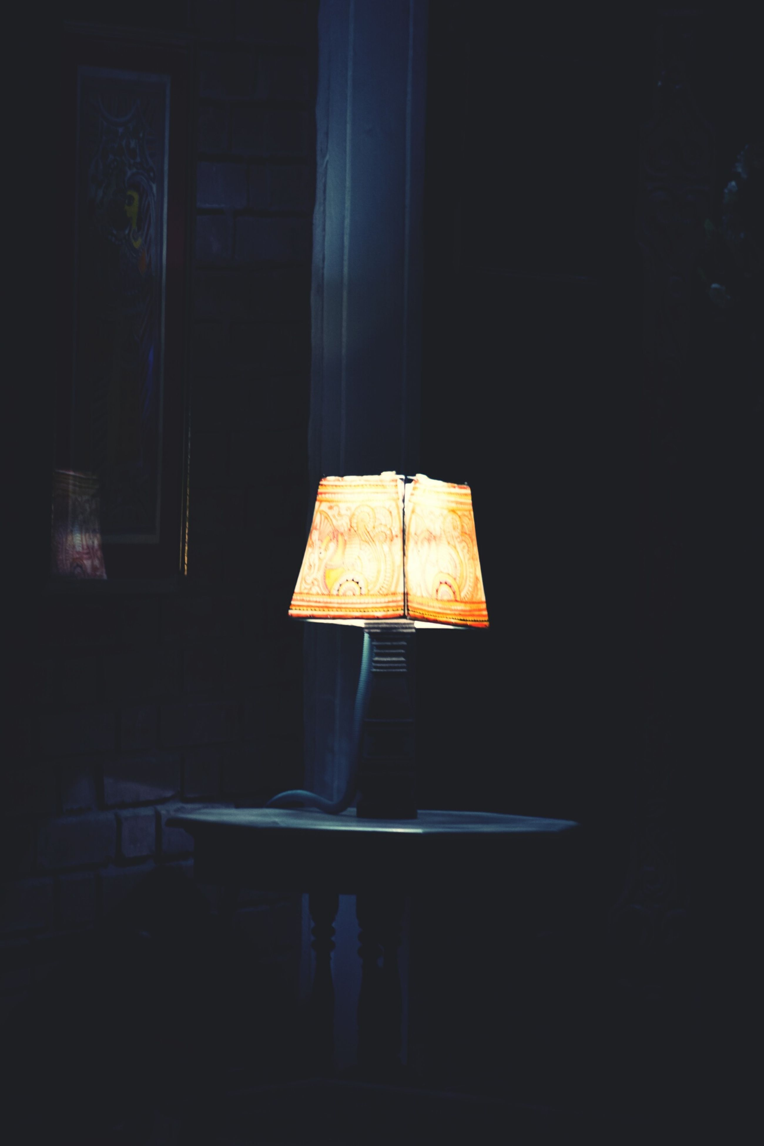 indoors, illuminated, dark, home interior, night, still life, wall - building feature, lighting equipment, table, copy space, burning, old, no people, close-up, darkroom, room, wood - material, house, flame, electric lamp