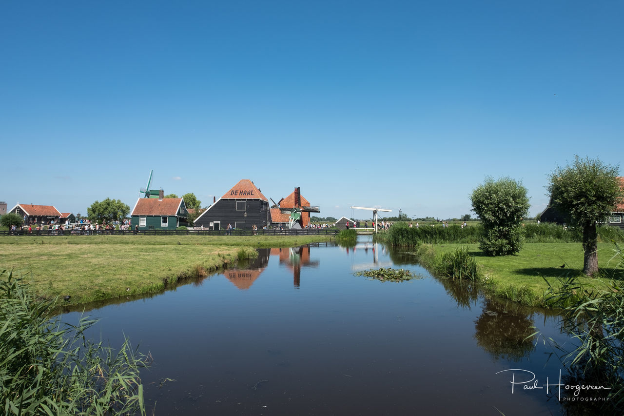 Tranquility @ Zaanse Schans Architecture Beauty In Nature Building Exterior Built Structure Clear Sky Day Grass House Landscape Nature No People Outdoors Reflection Sky Tranquility Tree Water Zaanse Schans