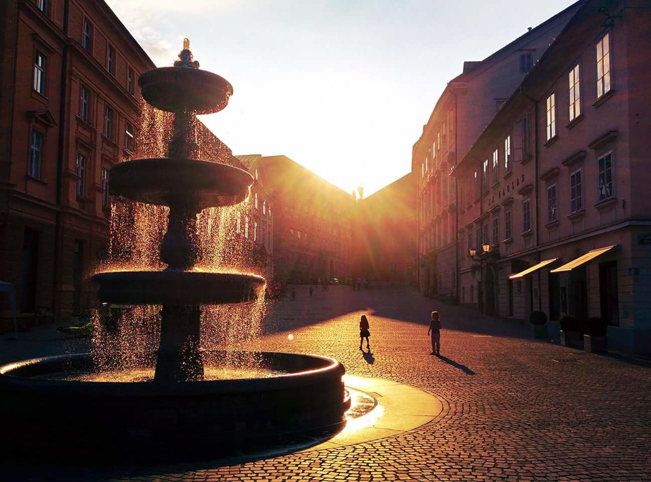 Building Exterior Water Built Structure Architecture City Outdoors Fountain YouthSunset Positive Vibes Ljubljanamoments Slovenia Beautiful Light Best Light Picoftheday Photooftheday Ljubljana Love Followme EyeEm New Here The Week Of Eyeem The City Light