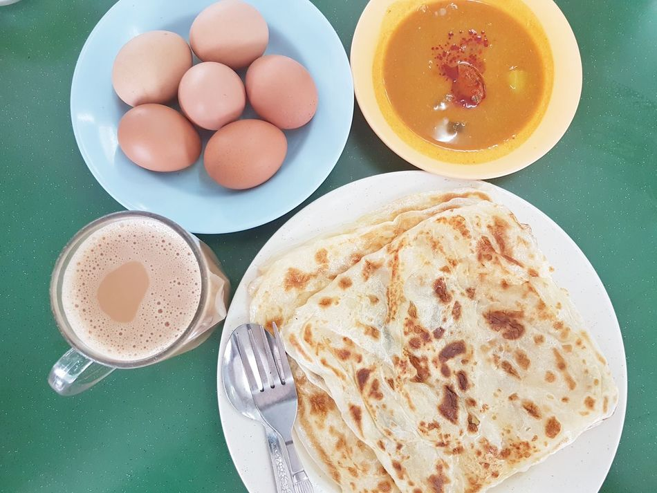 EyeEm Selects Food And Drink Plate Food High Angle View Directly Above Ready-to-eat Close-up Drink Teh Tarik Tehtarik Roti Canai Egg Eggs For Breakfast Curry Dhall Sauce Milktea Mamak Breakfast Malaysian Food Malaysian Breakfast Culture Unhealthy Food And Drink