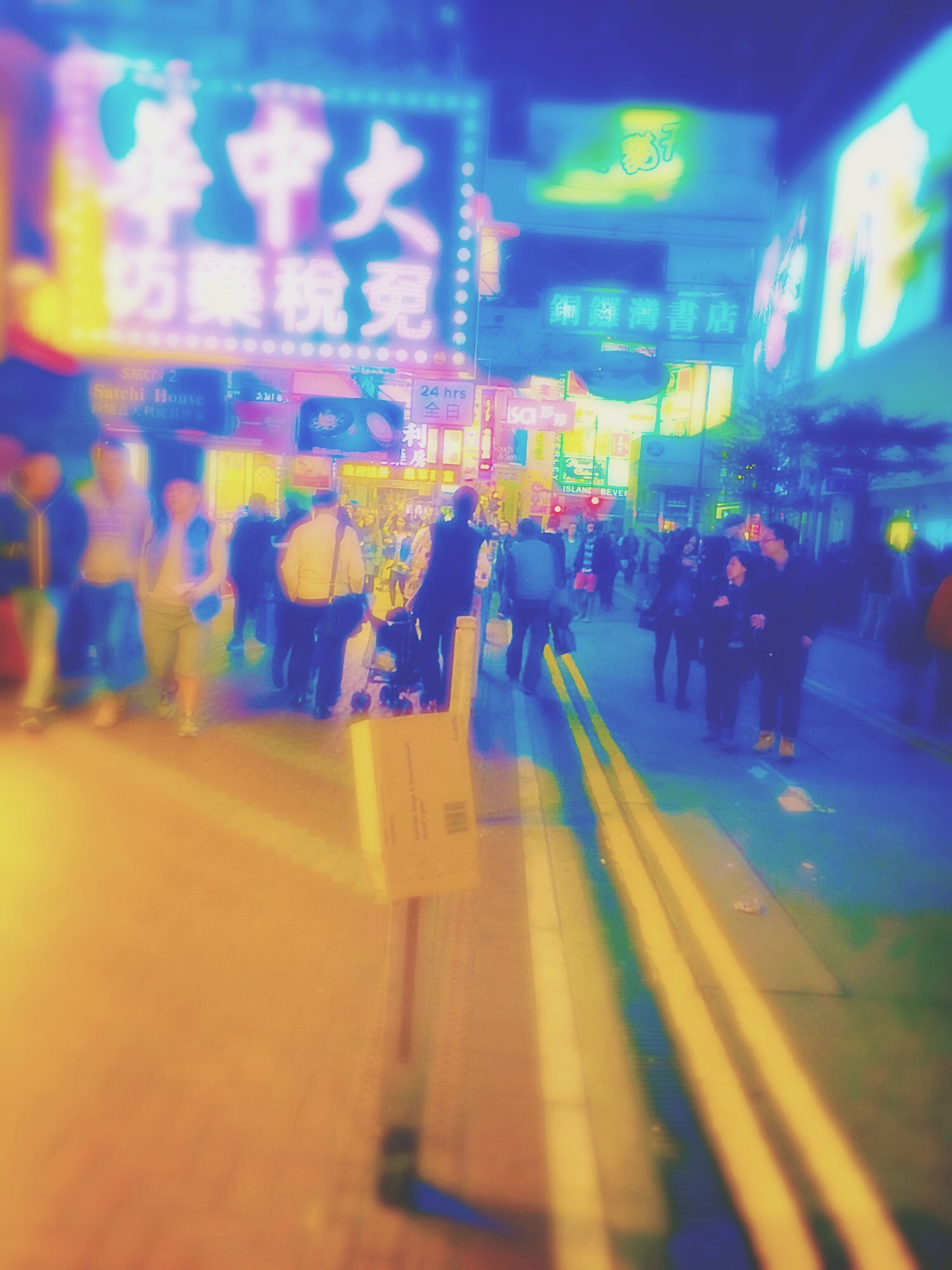 illuminated, transportation, lifestyles, men, person, city life, large group of people, indoors, blurred motion, walking, city, night, railroad station, leisure activity, public transportation, travel, street, incidental people, architecture