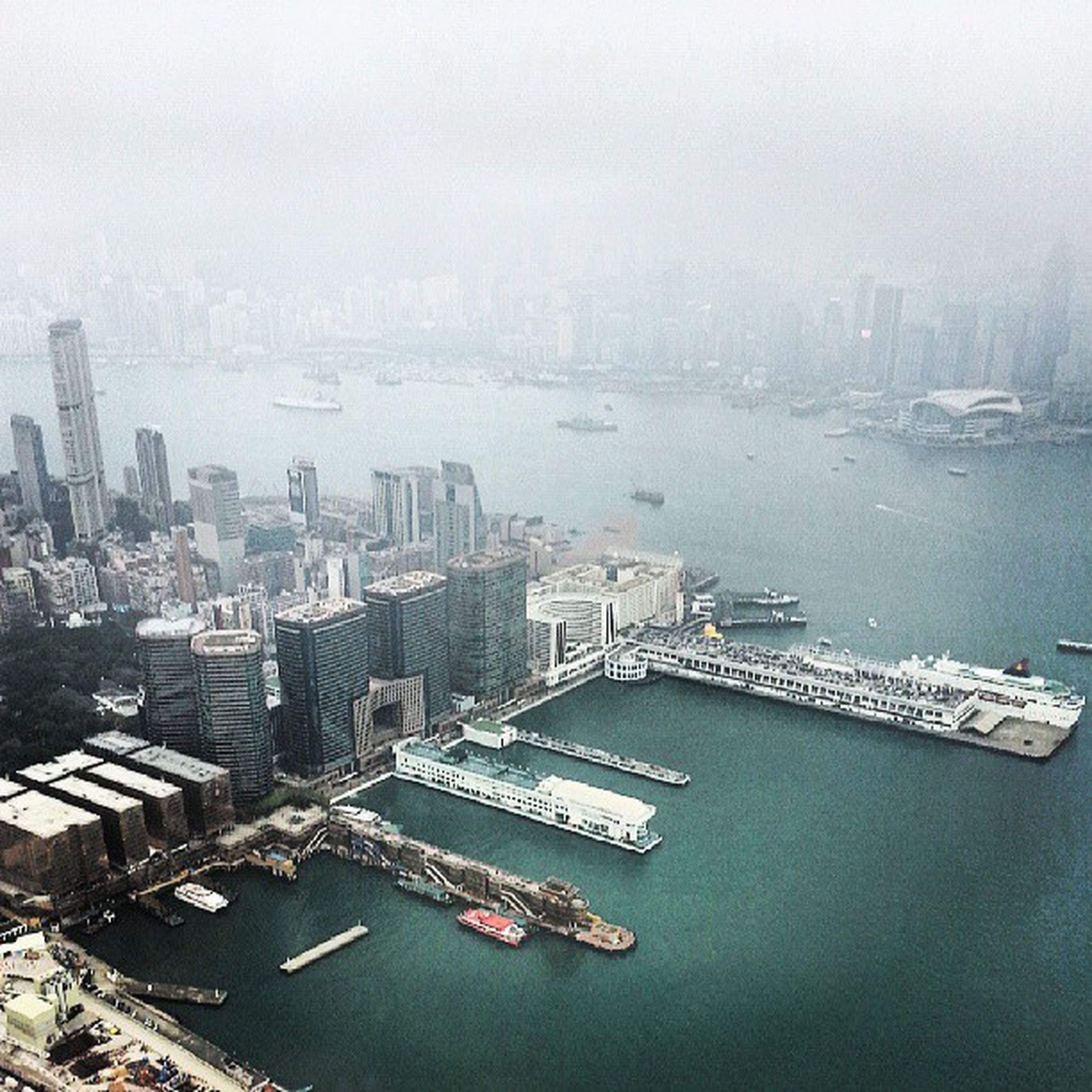 architecture, city, building exterior, water, built structure, cityscape, nautical vessel, transportation, high angle view, river, waterfront, mode of transport, skyscraper, sea, boat, crowded, harbor, urban skyline, sky, office building