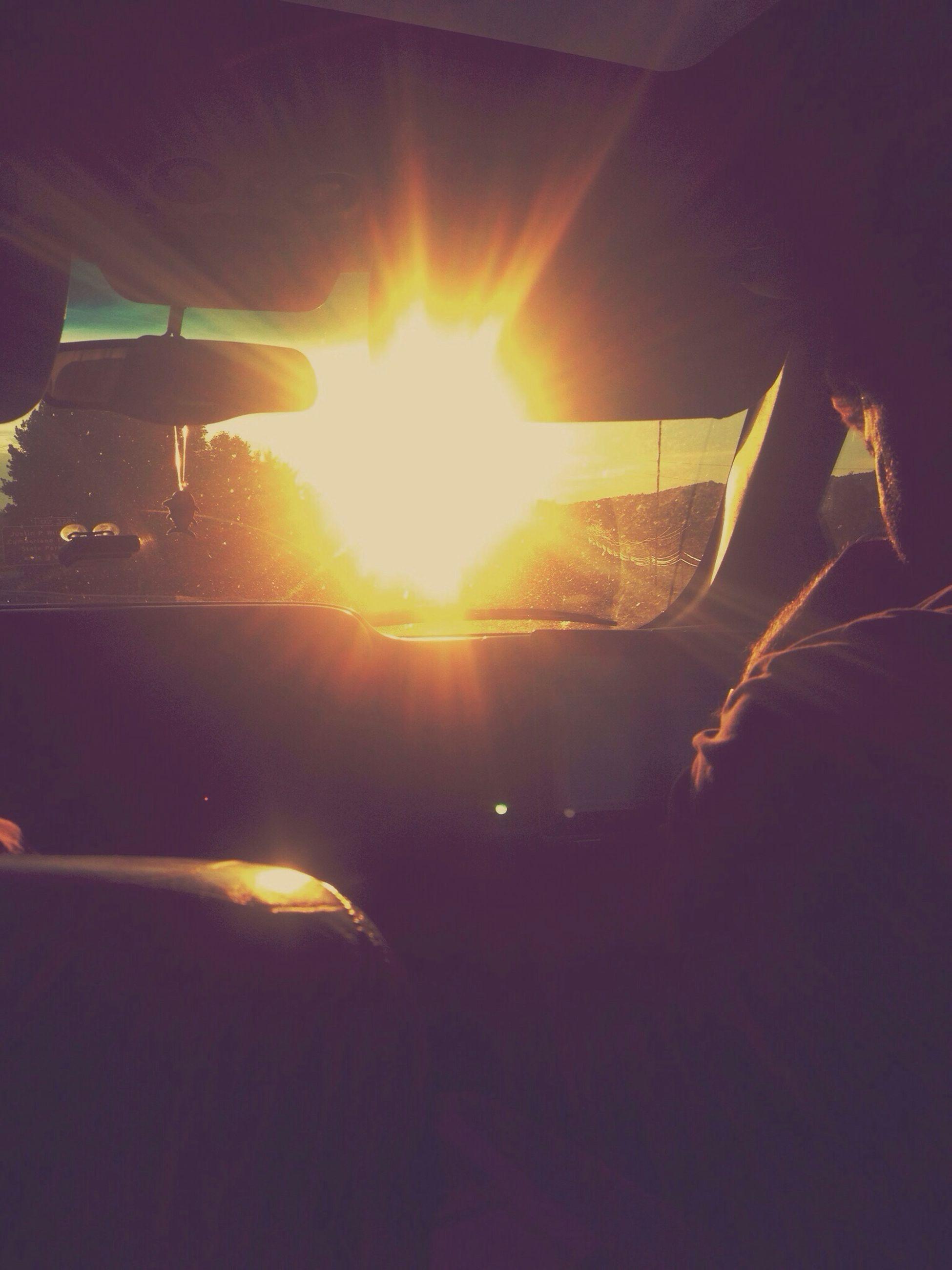 transportation, mode of transport, land vehicle, part of, unrecognizable person, leisure activity, lifestyles, silhouette, person, car, cropped, men, sunlight, lens flare, sunbeam, street, sun