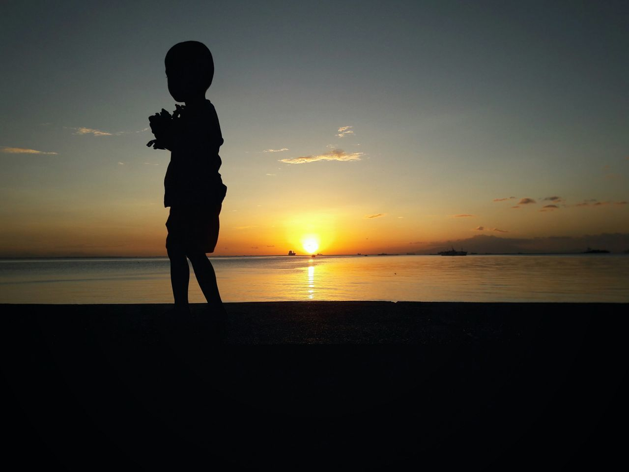 Little Boy Child One Boy Only Silhouette Sunset Horizon Over Water Childhood One Person Sunset Sky Urban Street Photography Sun Eyeem Philippines My Year My View Beginnings