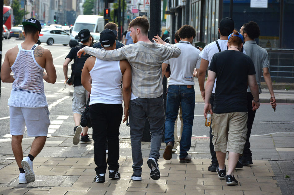 EAST LONDON VIBES Casual Clothing City City Life City Street Day Friends Full Length Hug Hugging A Tree Leisure Activity Lifestyles Medium Group Of People Mixed Age Range Outdoors Side By Side London Lifestyle