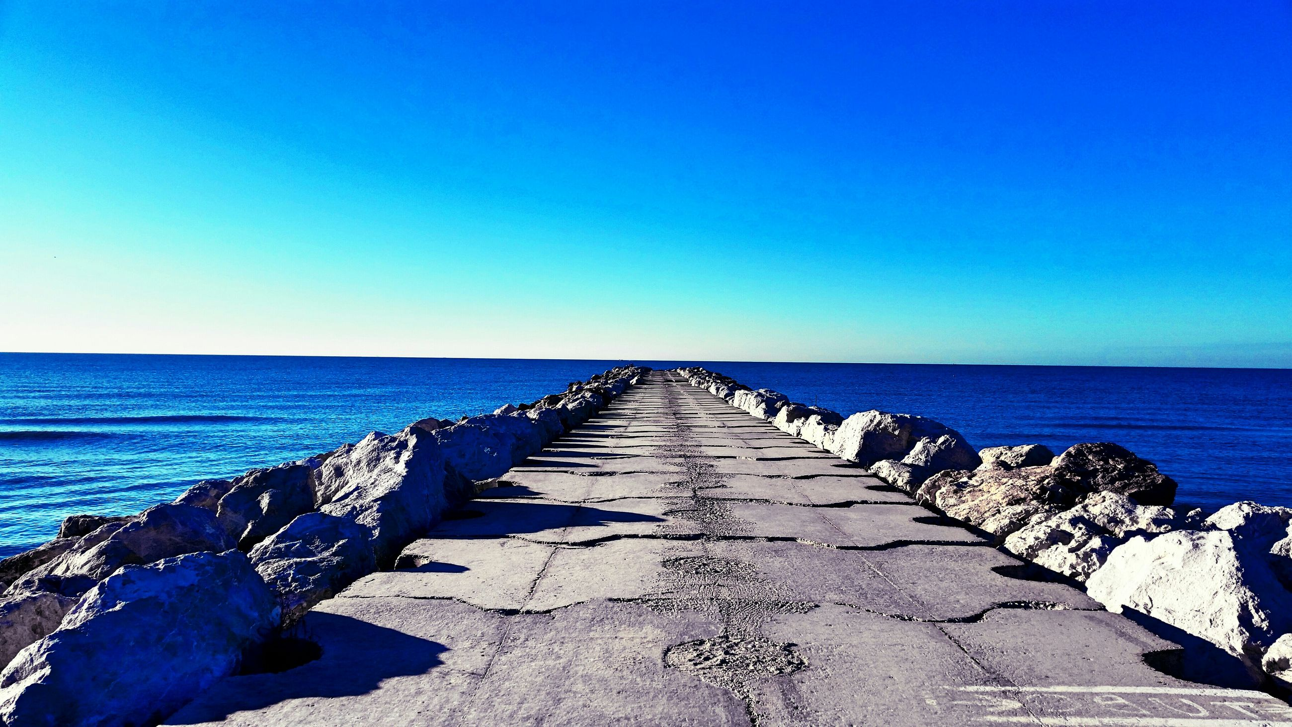 sea, clear sky, horizon over water, blue, copy space, water, tranquil scene, tranquility, the way forward, scenics, beauty in nature, nature, beach, diminishing perspective, long, idyllic, outdoors, day, shore, no people