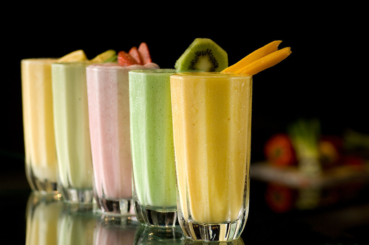 drink, drinking glass, food and drink, smoothie, healthy eating, refreshment, drinking straw, green color, freshness, focus on foreground, no people, cocktail, fruit, milkshake, close-up, food, indoors, ready-to-eat, day
