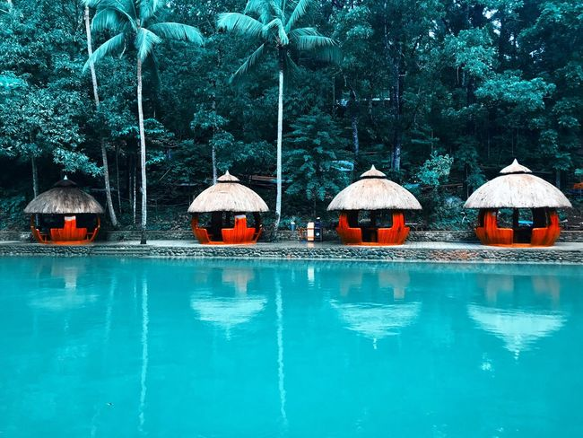 Trying an orange and teal look 😊 Traveling Travel Destinations Philippines Water Nature Outdoors Tranquility Tranquil Scene Reflection Beauty In Nature Tree Scenics No People