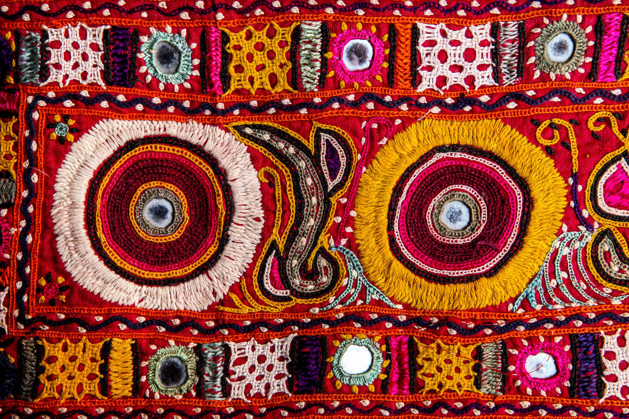 Multi Colored Pattern Design Creativity Art And Craft Full Frame Backgrounds Ornate Close-up No People Indoors  Day Embroidery Artistic Rural Traditinal India Folk Folk Art  Kutch Kutch Embroidery Gujrat
