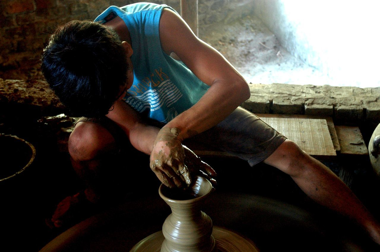 Arts And Crafts Clay Pot Local Culture One Person Pottery Pottery Art Pottery Maker Pottery Passion Real People Sitting