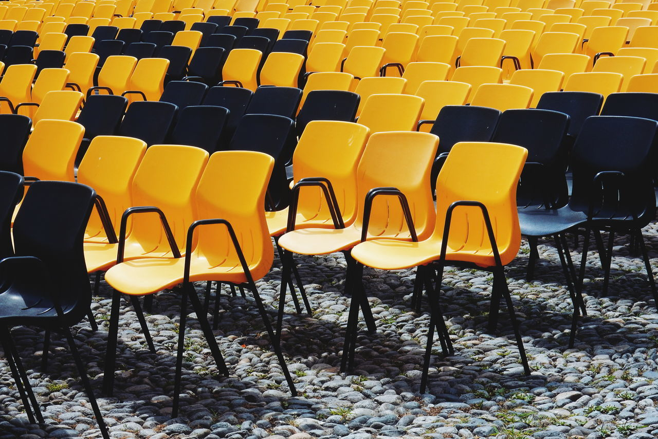 Film festival in Locarno Absence Abundance Arrangement Beauty In Nature Chair Day Empty Film Festival Furniture Group Of Objects In A Row Locarno Nature No People Orange Color Piazza Grande Repetition Seat Side By Side TakeoverContrast Yellow Locarno, Switzerland The Golden Leopard Switzerland