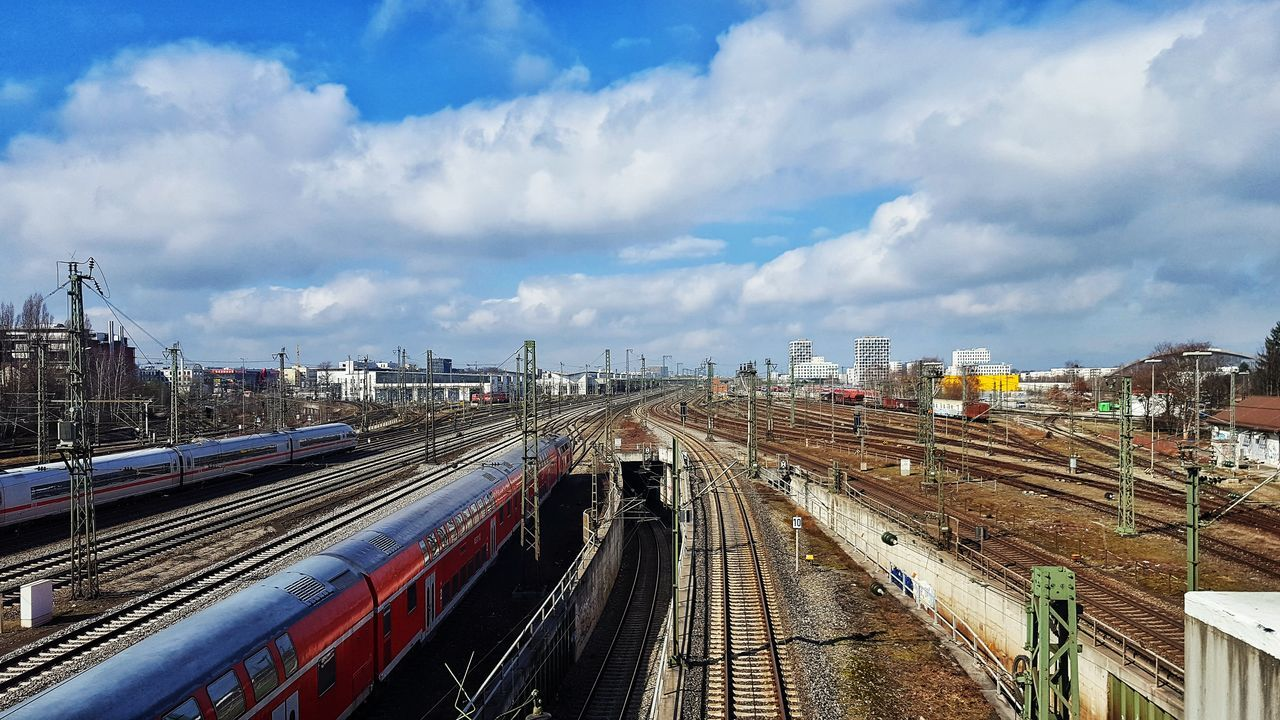Architecture Bridge - Man Made Structure Building Exterior Built Structure City Cloud - Sky Day High Angle View Mode Of Transport No People Outdoors Public Transportation Rail Transportation Sky The Way Forward Train - Vehicle Transportation