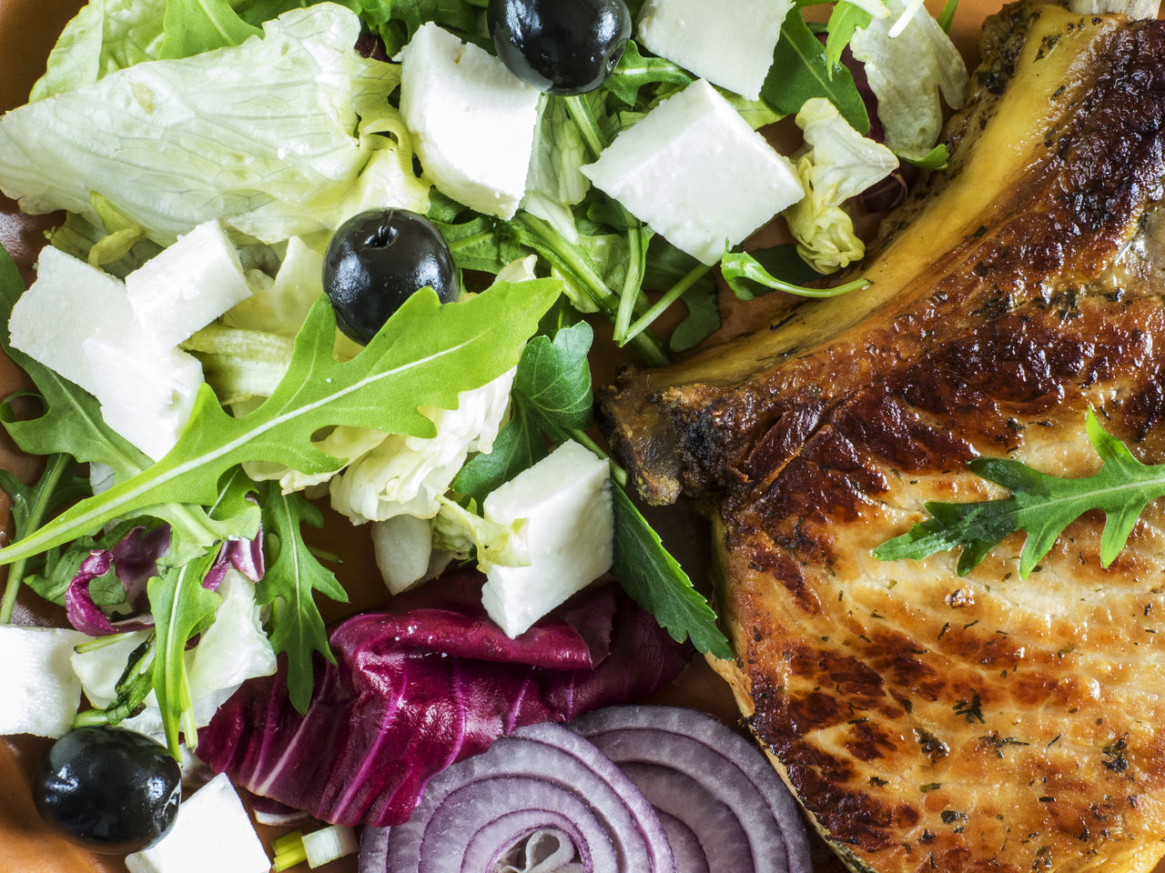 Roasted pork chop on a plate with a green salad, red onion, soft cheese and olives Cheese Chop Close-up Day Food Food And Drink Freshness Greek Salad Green Healthy Eating Indoors  Leaf Leaf Vegetable Lettuce No People Olives Onion Plate Pork Relaxing Roasted Salad Soft