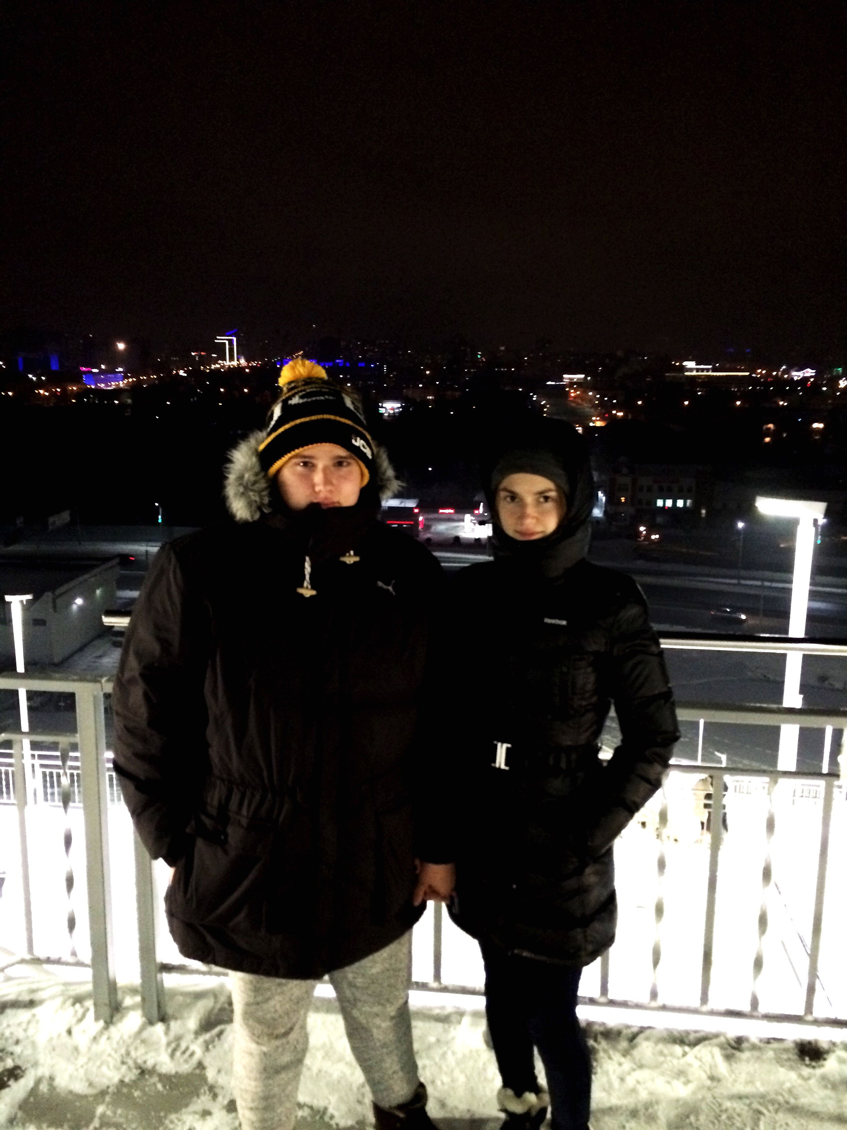 two people, night, looking at camera, portrait, togetherness, city, winter, young adult, people, smiling, archival, females, young women, real people, leisure activity, warm clothing, adult, adults only, bonding, outdoors, headwear