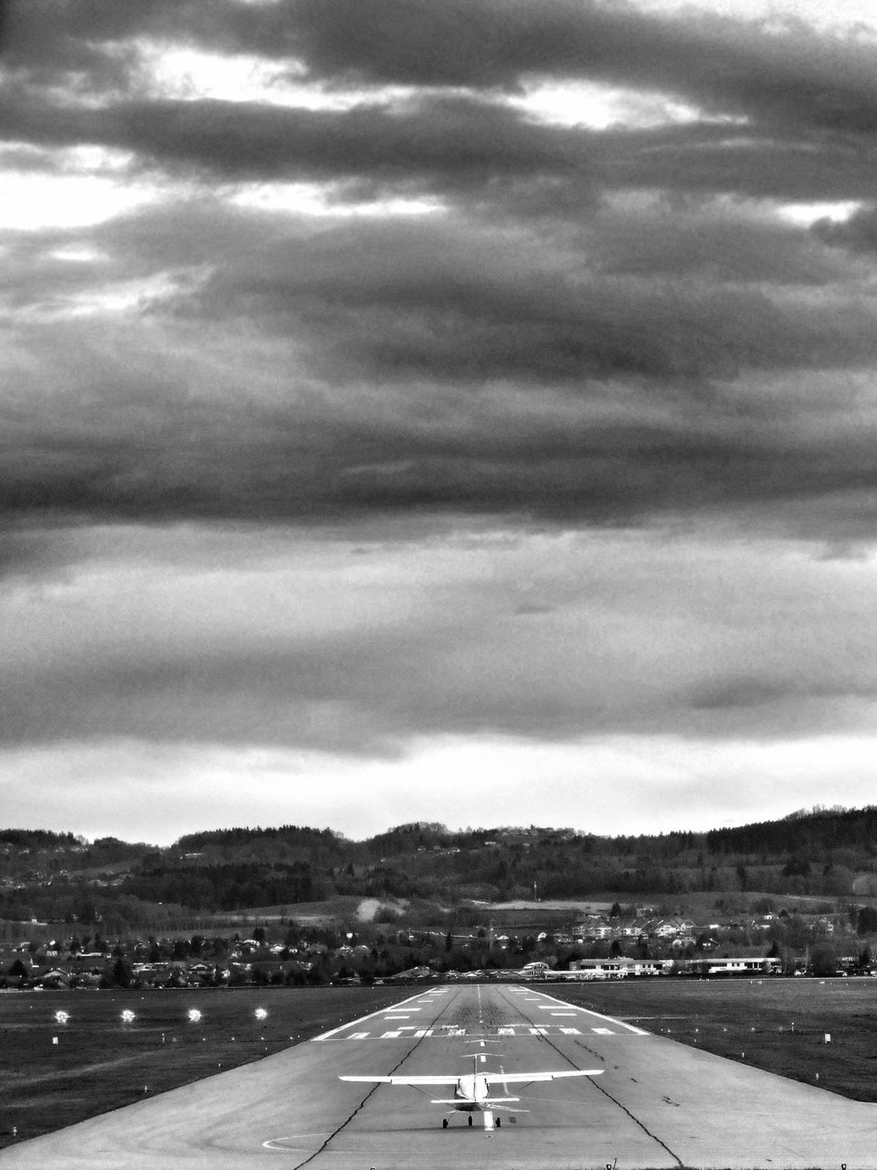 Runway to hell Telling Stories Differently The Week On Eyem EyeEm Best Shots FUJIFILM X-T1 Fine Art Photography Airplane Air Vehicle Flying Picoftheday Phoneography Finding New Frontiers EyeEmBestPics Shootermag Eye4photography  City Life Black And White Photography Adapted To The City My Year My View French Alps Cloud - Sky Bad Weater On The Way Miles Away Minimalism Outdoors