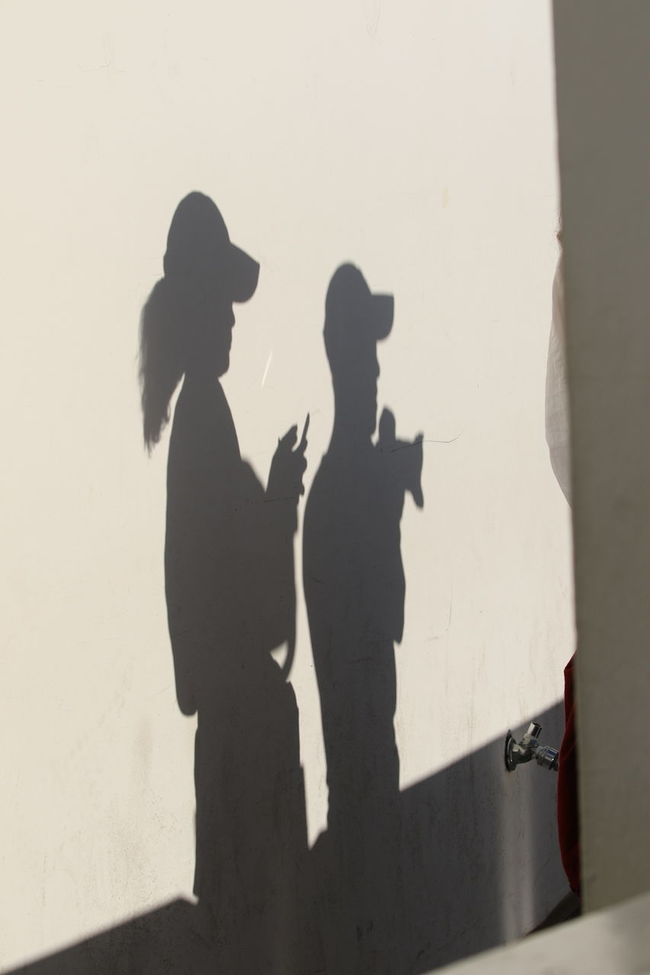 Common Contrasts Couple Focus On Shadow Left To Right Photographers Shadows Shadows On The Floor Silhouette Togetherness White Wall