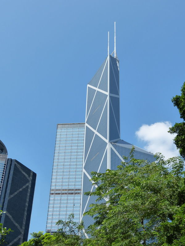Architecture Bank Of China Building Exterior Built Structure Business Finance And Industry City Clear Sky Day Low Angle View Modern Nature No People Outdoors Sky Skyscraper Social Issues Tree