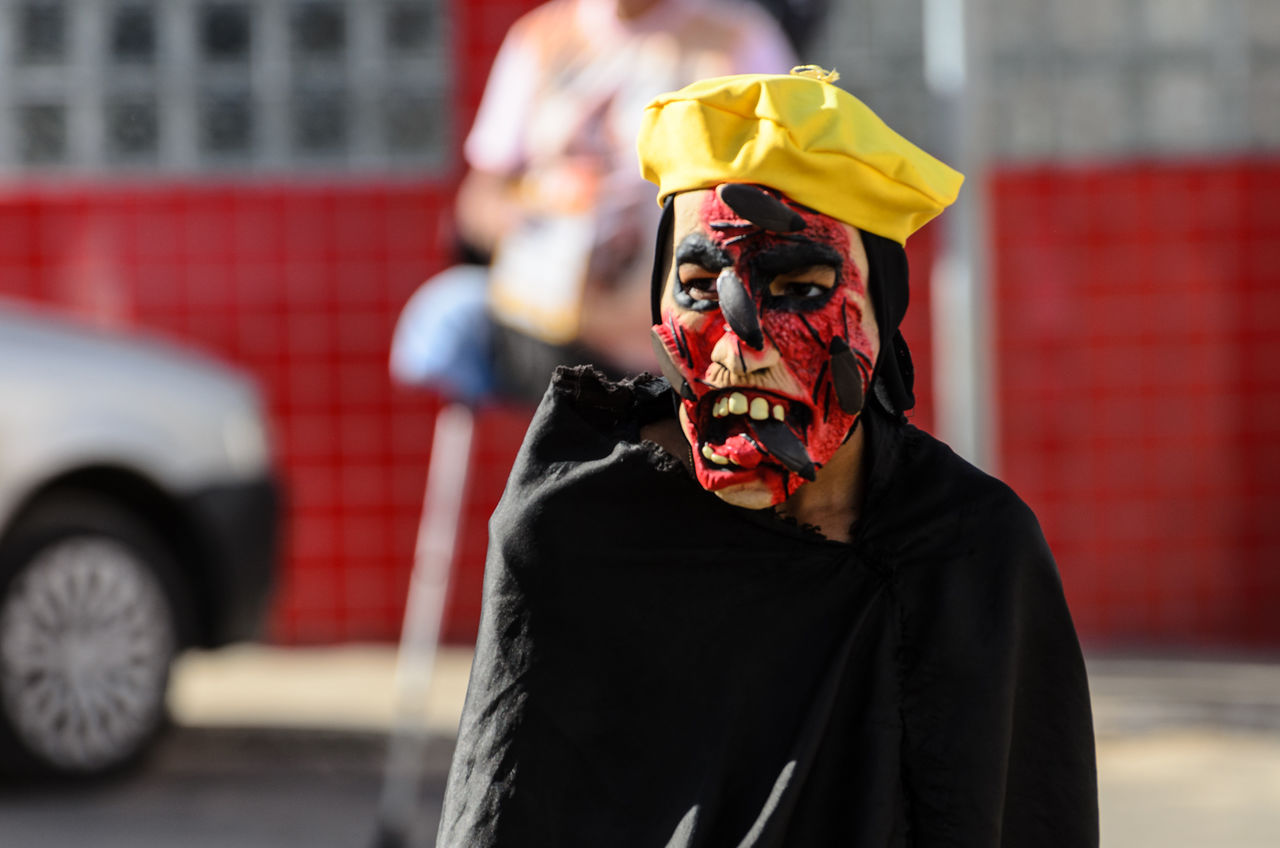 real people, red, costume, focus on foreground, outdoors, one person, leisure activity, celebration, lifestyles, halloween, day, disguise, men, clown, people