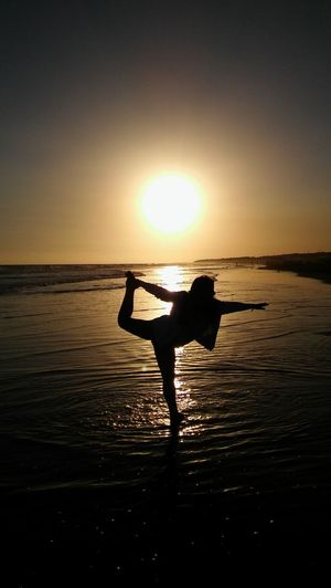 Beach Beauty In Nature Buenos Aires, Argentina  Day Flexibility Full Length Horizon Over Water Jumping Lifestyles Nature Necochea. Argentina One Person Outdoors Real People Scenics Sea Silhouette Skill  Sky Sport Sun Sunset Tranquil Scene Water Young Adult