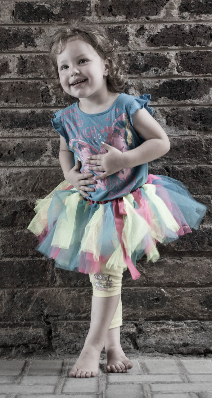 childhood, full length, one person, girls, dancing, smiling, happiness, outdoors, ballet dancer, front view, looking at camera, one girl only, standing, day, ballet, child, children only, portrait, cheerful, real people, people