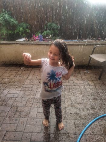 Children Only Childhood One Girl Only Water Girls Child Standing Wet Front View Elementary Age Day Fun Real People Motion People Outdoors Full Length Summertime Hot Day RainyDay Playing In The Rain Miami, FL The Week On EyeEm Mix Yourself A Good Time