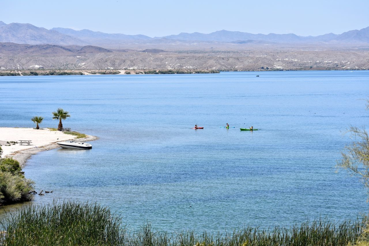 Lake Outdoors Day Water Landscape Mountain Sunny Tranquility Scenics Beauty In Nature Nature Tranquil Scene No People Blue Beach Sky Mountain Range Nautical Vessel Tree