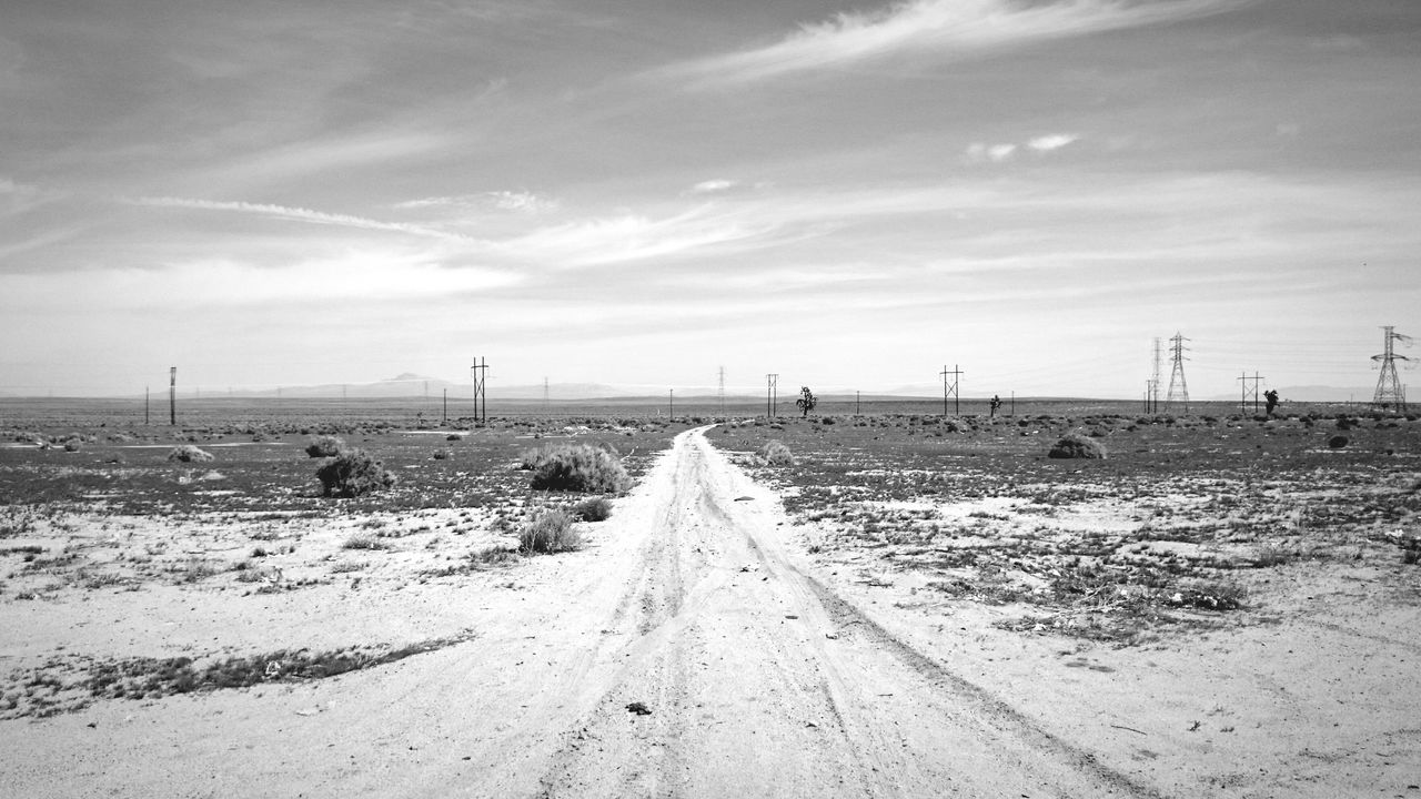 Desolate Desert Power Lines Sand Dirt Road Vanishing Point Black And White Blackandwhite Monochrome Mojave Desert Mojave Badlands California Desert