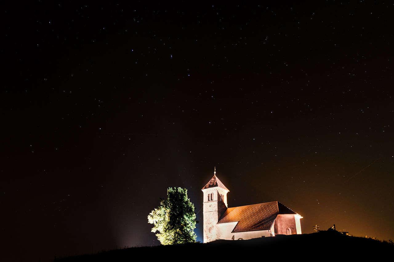 Nightscape with church and ursa major stars. Small church and tree on a hill are lit, with night sky full of stars and constellation ursa major. Architecture Astronomy Building Exterior Built Structure Church Constellation Galaxy Hill Nature Night Nightphotography No People Outdoors Place Of Worship Religion Scenics Sky Slovenia Star - Space Star Field Tree