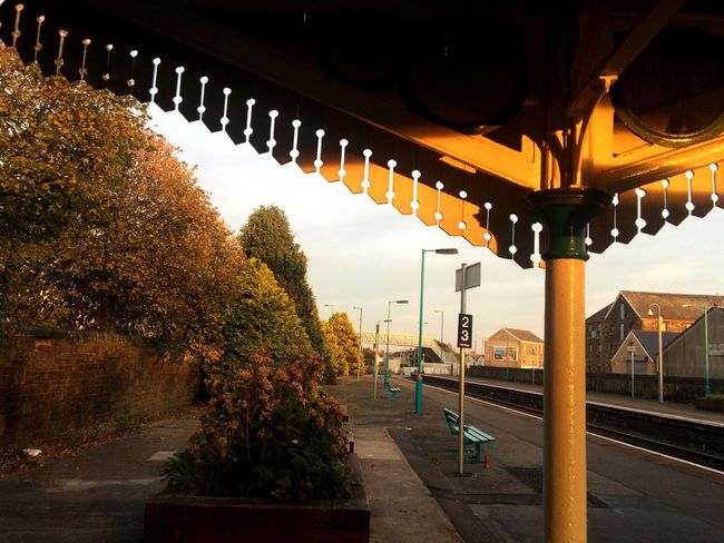 Sun setting on Llanelli station. Railway Traveling Public Transportation Sunset Light And Shadow Tracks Trains Wales