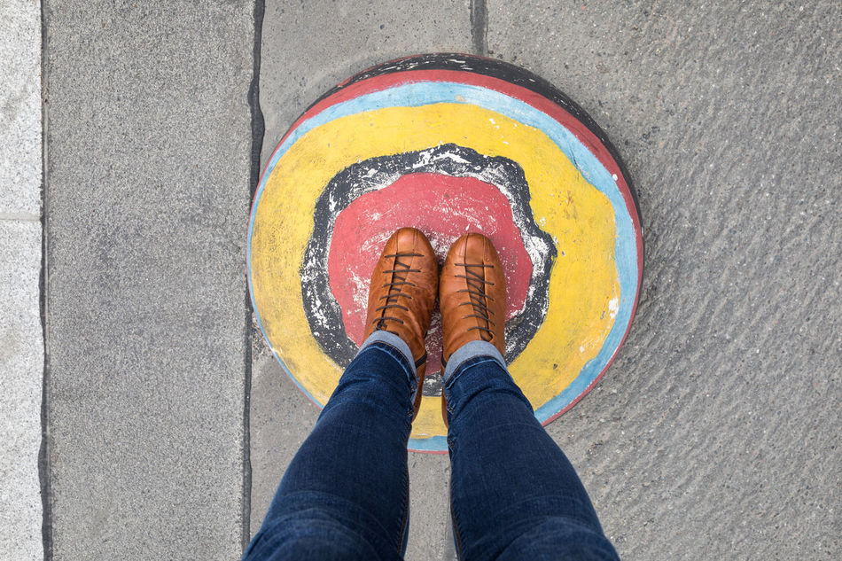 Standing on a colorful hemisphere Adult Asphalt Casual Clothing Concrete Directly Above Hemisphere High Angle View Human Body Part Human Foot Human Leg Lifestyles Low Section Multi Colored One Person One Woman Only Paint Personal Perspective Real People Road Shoe Sphere Standing Street Textured  Vibrant Color