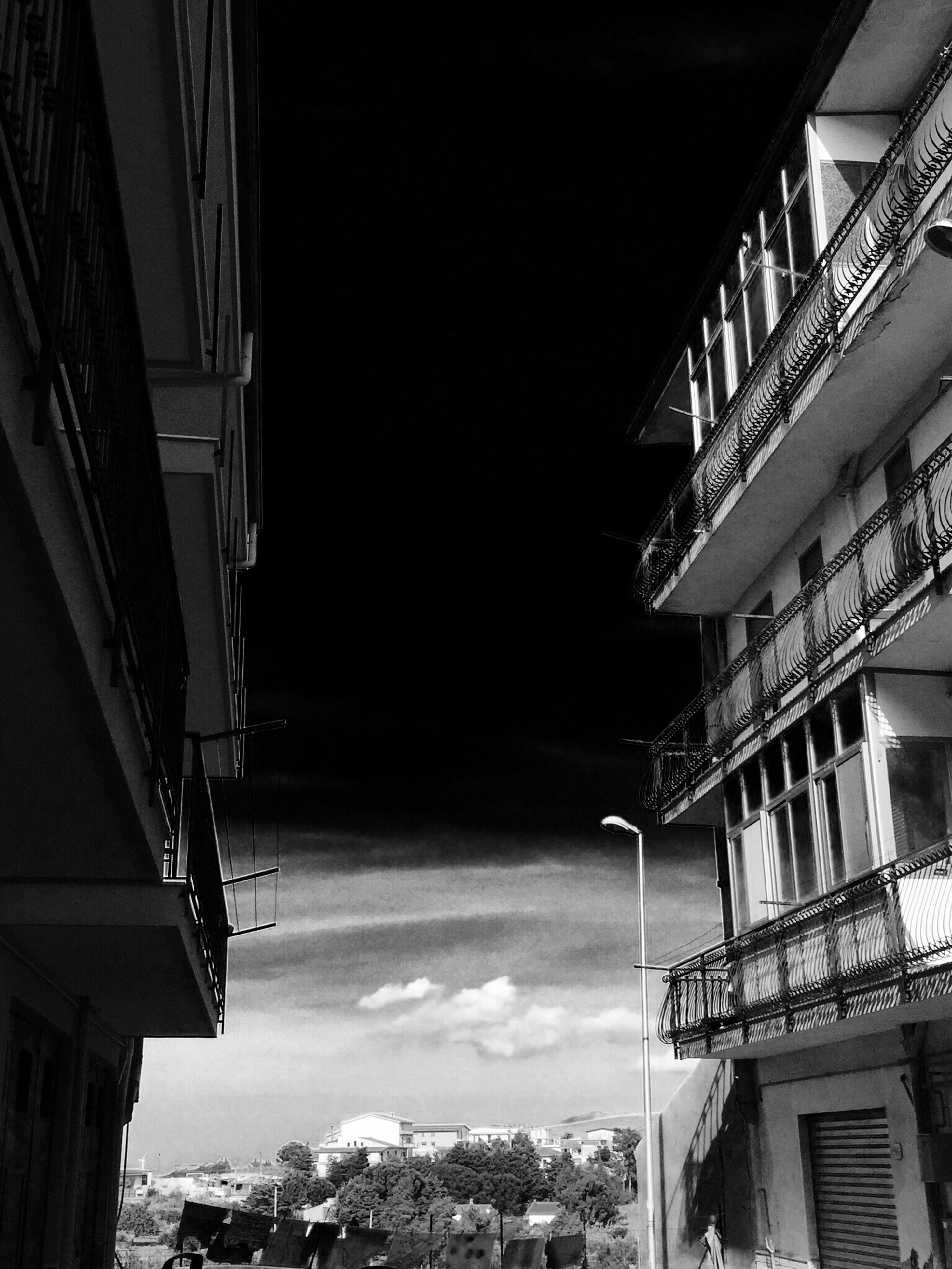architecture, built structure, building exterior, residential building, residential structure, low angle view, city, building, house, residential district, sky, balcony, day, no people, outdoors, roof, window, city life, cityscape, apartment