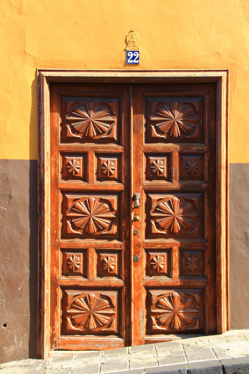 door, closed, wood - material, day, safety, no people, architecture, built structure, outdoors, building exterior, yellow, close-up