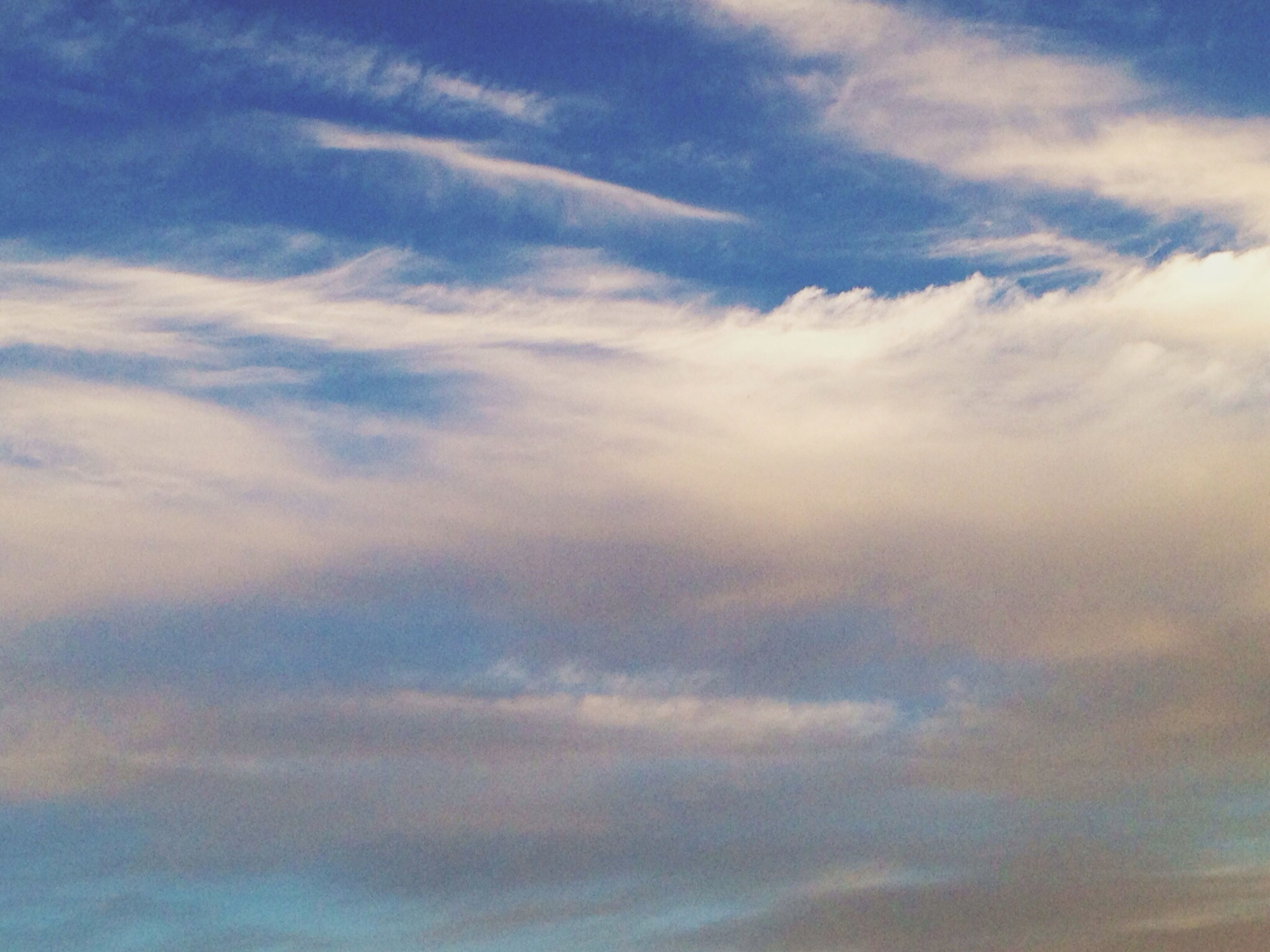 sky, cloud - sky, low angle view, tranquility, beauty in nature, scenics, cloudy, sky only, tranquil scene, nature, cloud, backgrounds, cloudscape, blue, idyllic, full frame, outdoors, no people, day, weather
