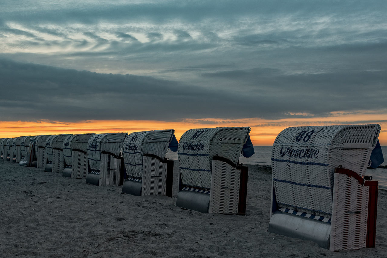beach chairs Baltic Sea Beach Beach Chairs Calmness Early Morning Following Orders Hollidays In Series Morning Sky No People, Outddor Sand Tourists White Beach Chairs