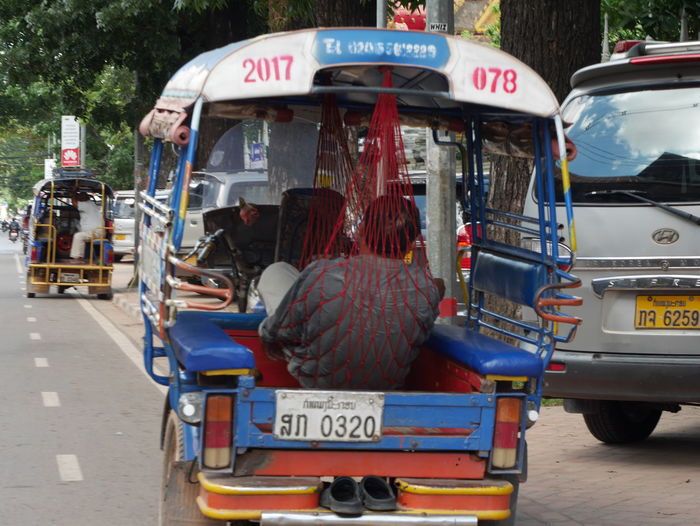 Day Land Vehicle Mammal Mode Of Transport No People Outdoors Rear View Red Road Stationary Text Took Took Transportation TukTuk Tuktukdriver Let's Go. Together.