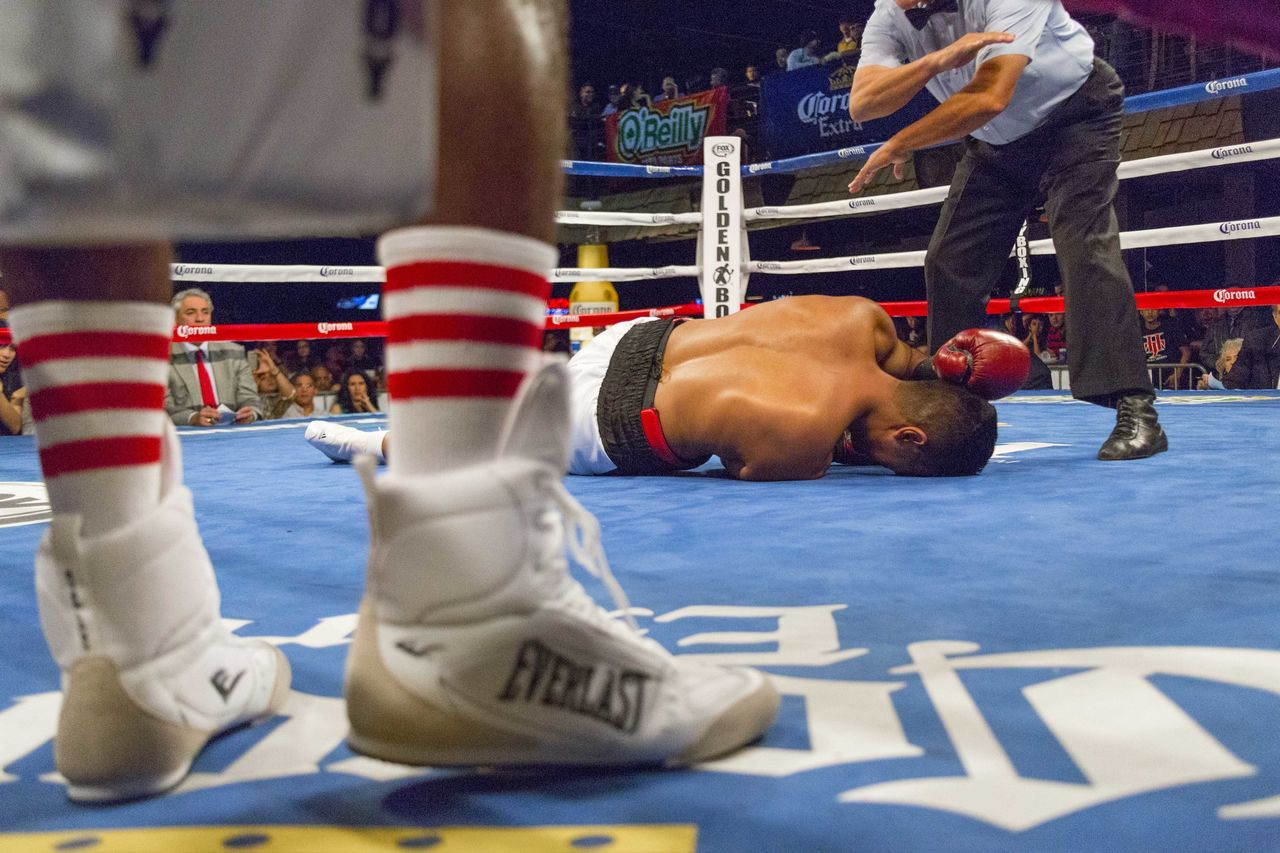 Boxing in San Antonio, Texas Blue Boxing Canvas Shoe Colorful Competition Human Leg K Knockout Men Out For The Count People Real People Referee7 San Antonio Skill  Sport Textured  TK USA