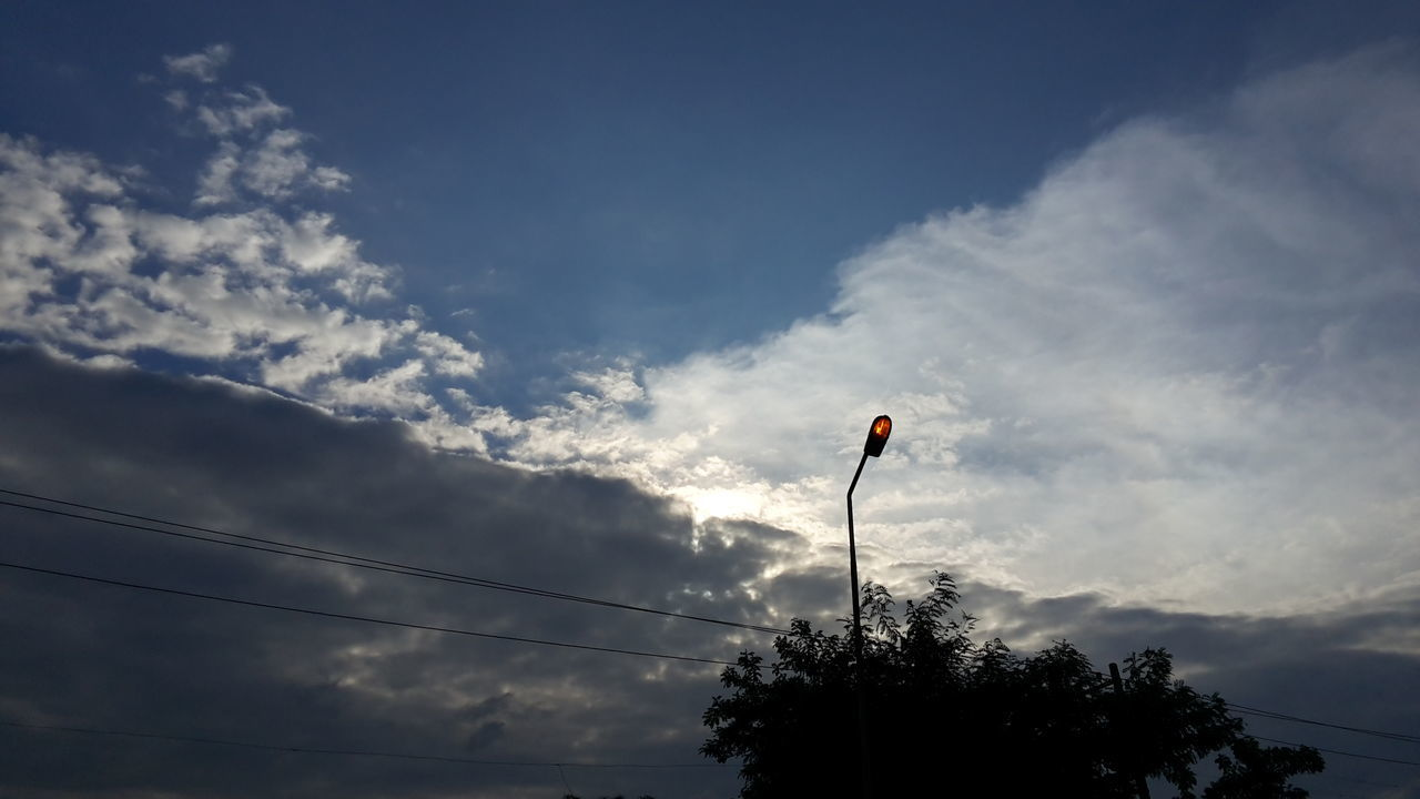 sky, cloud - sky, low angle view, tree, outdoors, flag, nature, day, no people, beauty in nature