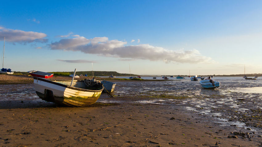 Low Tide Resting Christchurch Harbour Beach Beauty In Nature Boat Cloud - Sky Day Hengistbury Head Horizon Over Water Mode Of Transport Moored Mudeford Nature Nautical Vessel No People Outdoors Outrigger Sand Scenics Sea Shore Sky Tranquility Transportation Water