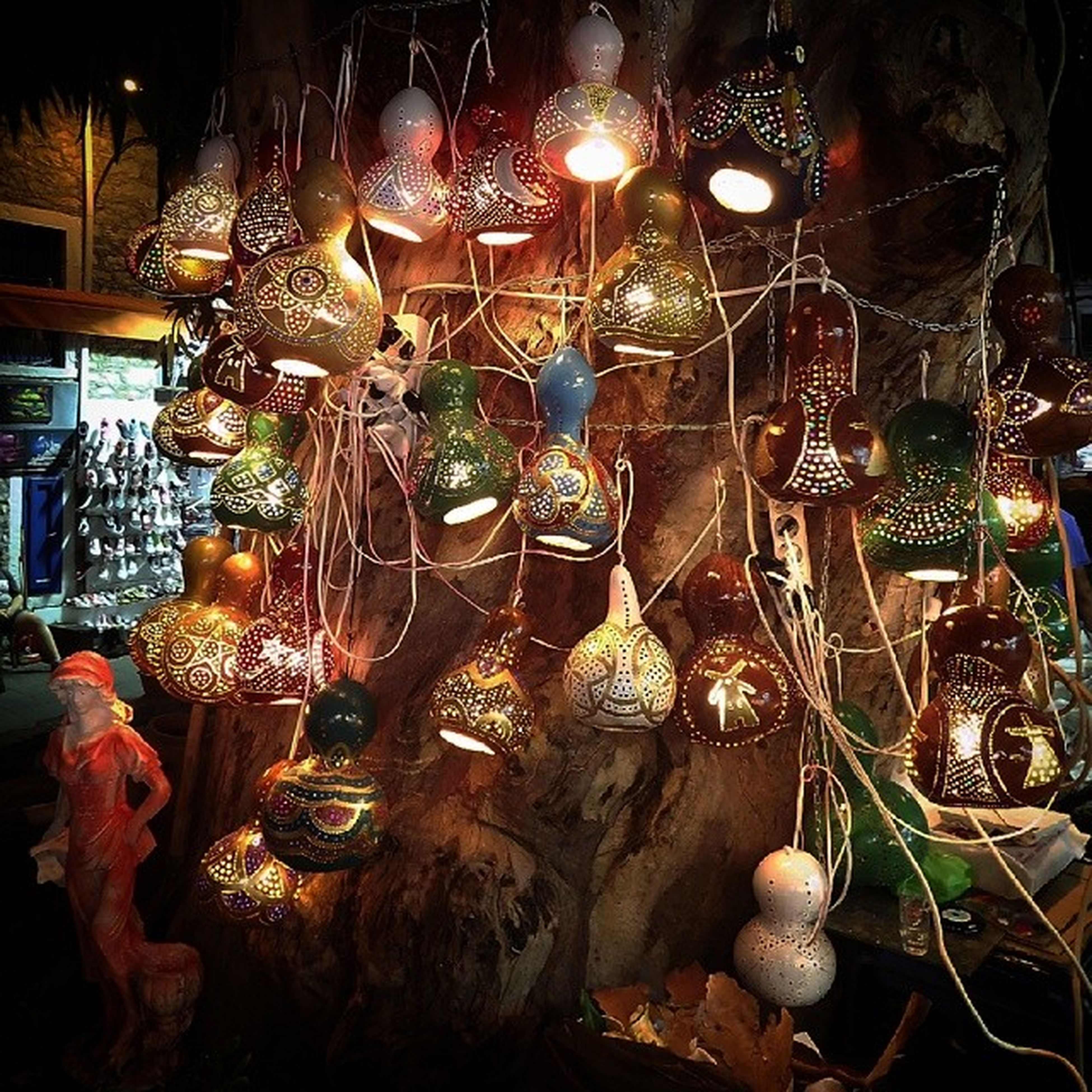 illuminated, lighting equipment, night, indoors, hanging, large group of objects, abundance, decoration, electricity, chair, lit, electric light, glowing, variation, light - natural phenomenon, electric lamp, candle, table, arrangement, retail
