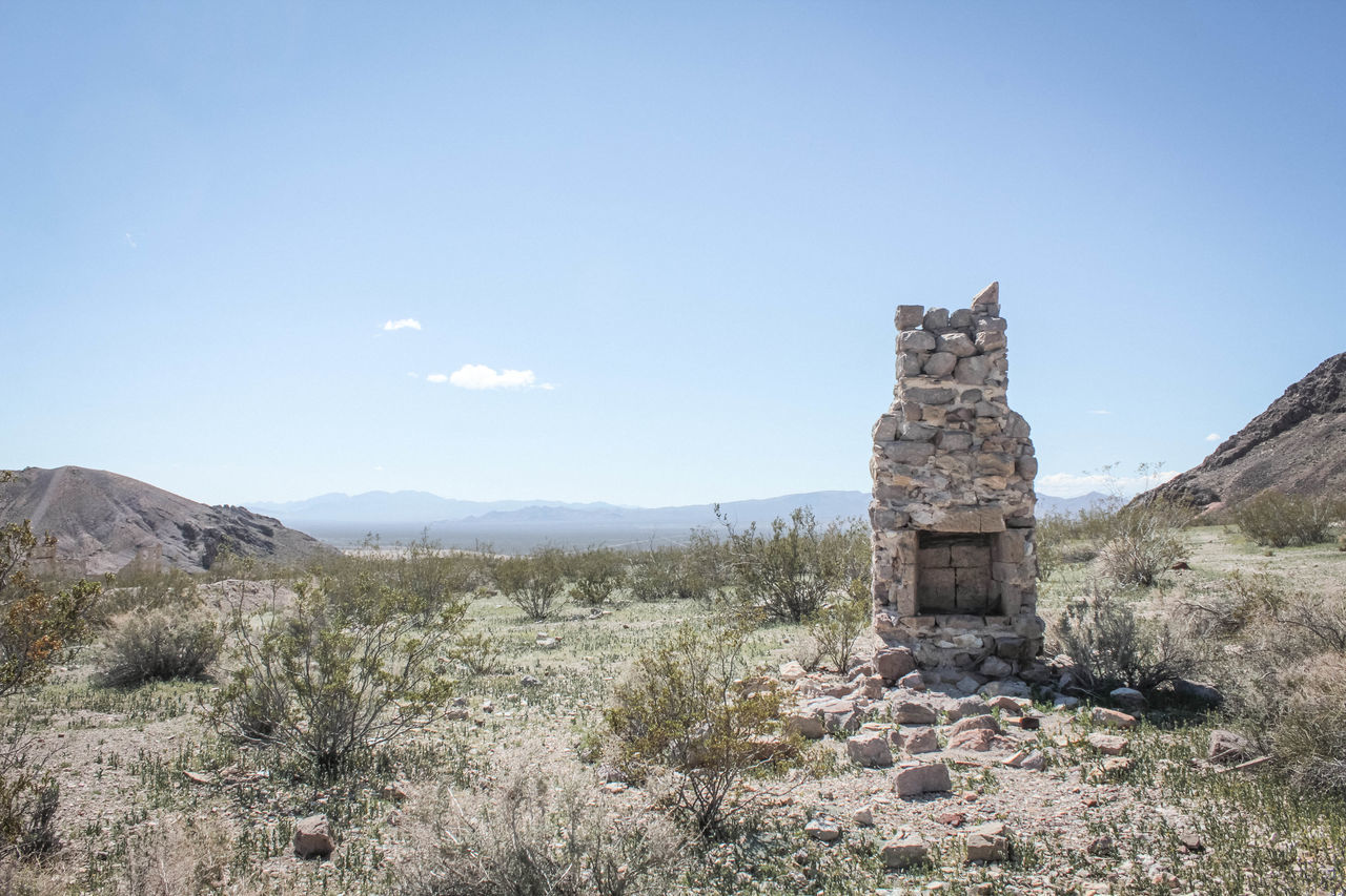 Abandoned Beauty In Nature Blue Day Fireplace Grass Growth Hill Horizon Over Land Idyllic Landscape Mountain Mountain Range Nature No People Eyeemphoto Non-urban Scene Outdoors Plant Remote Ruins Rural Scene Scenics Sky Tranquility The Secret Spaces