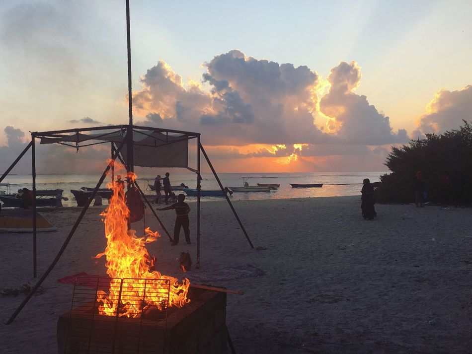 Sunset Sea Sky Orange Color Heat - Temperature Flame Cloud - Sky Water Burning Nature Outdoors Nautical Vessel Horizon Over Water Real People Beauty In Nature Beach Maldives Local Beach Local Island Villingili Barbecue Beach Barbecue Fire Heat EyeEmNewHere Miles Away