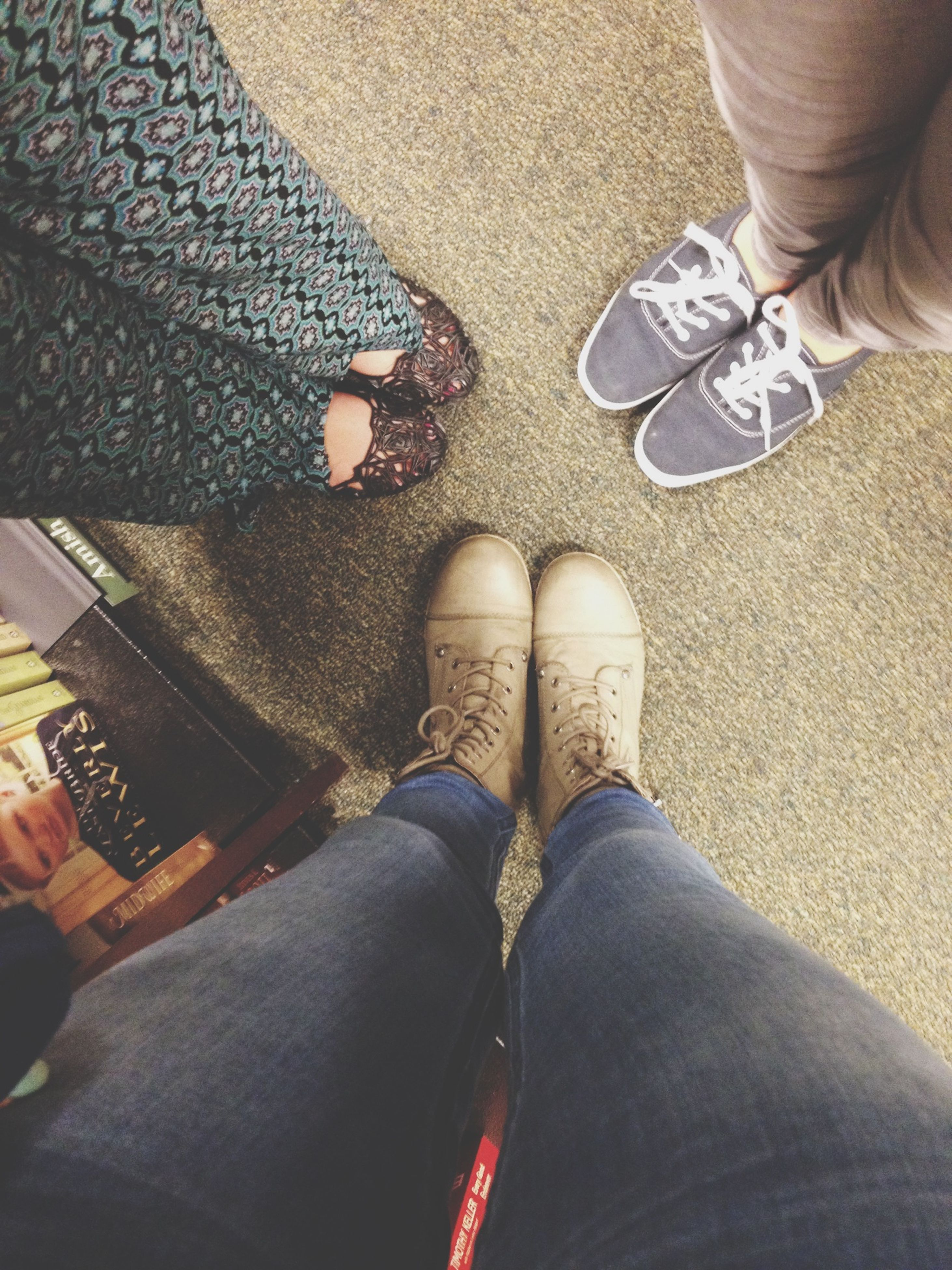low section, person, personal perspective, lifestyles, shoe, human foot, leisure activity, men, high angle view, standing, jeans, part of, footwear, togetherness, unrecognizable person, casual clothing