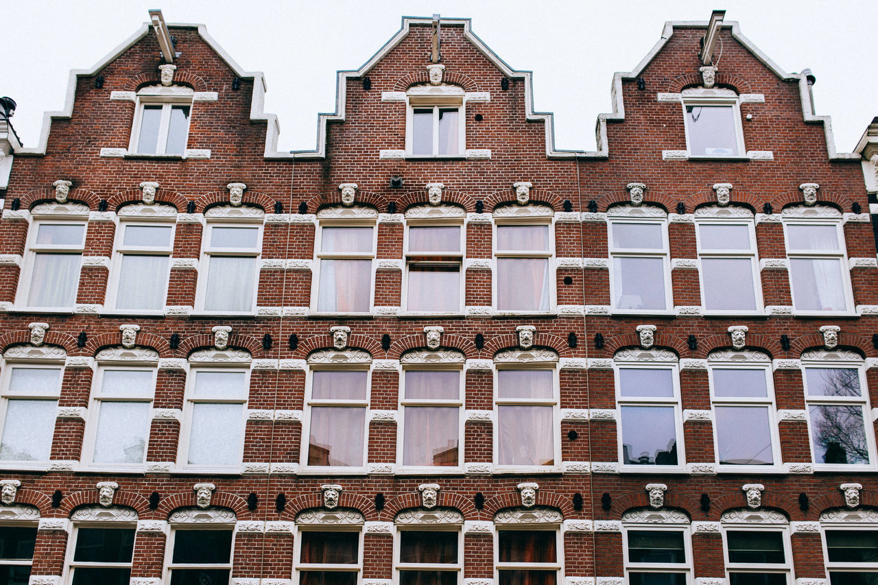 A Wintery Amsterdam... All Streets Amsterdam Architectural Feature Architecture Balcony Building Building Exterior Built Structure City Clear Sky Day Exterior Façade History In A Row Low Angle View Outdoors Repetition Residential Building Residential Structure Side By Side Window Your Amsterdam EyeEm X Google - Your Amsterdam