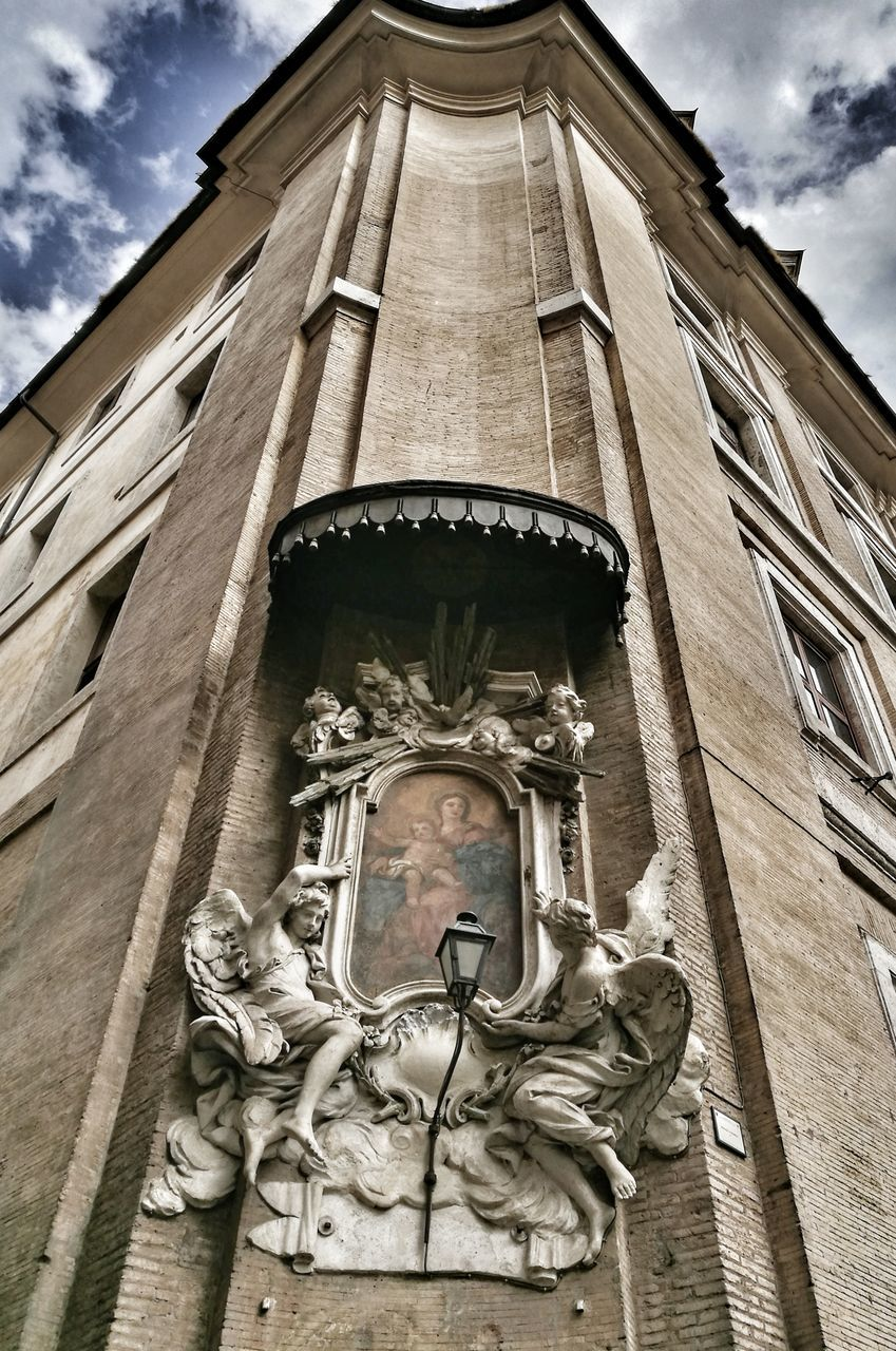 statue, male likeness, low angle view, sculpture, cloud - sky, human representation, religion, architecture, built structure, sky, building exterior, spirituality, day, no people, history, outdoors, place of worship